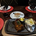 Rump Steak with baked potato and a great South African red wine at Godfathers
