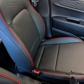 Artificial leather with red trim